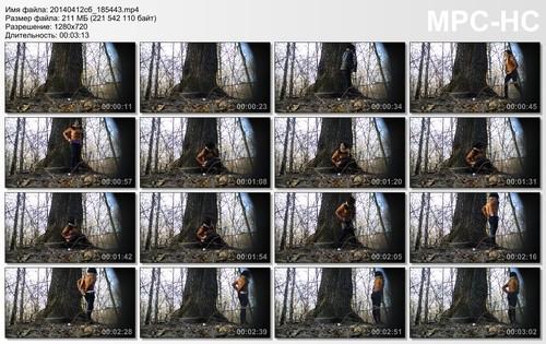 beautiful brunette in jeans pisses near a tree