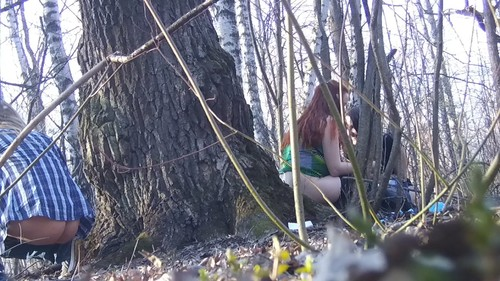 pregnant red-haired girl with two girlfriends pisses near a tree