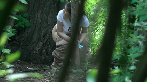 Asian woman pissing in bushes