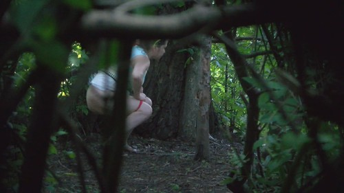 plump blonde pissing in the bush